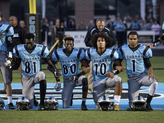 The Power Of Protest: Courageous Stand By Four High School Athletes Pushes Michigan School Towards Addressing Racism